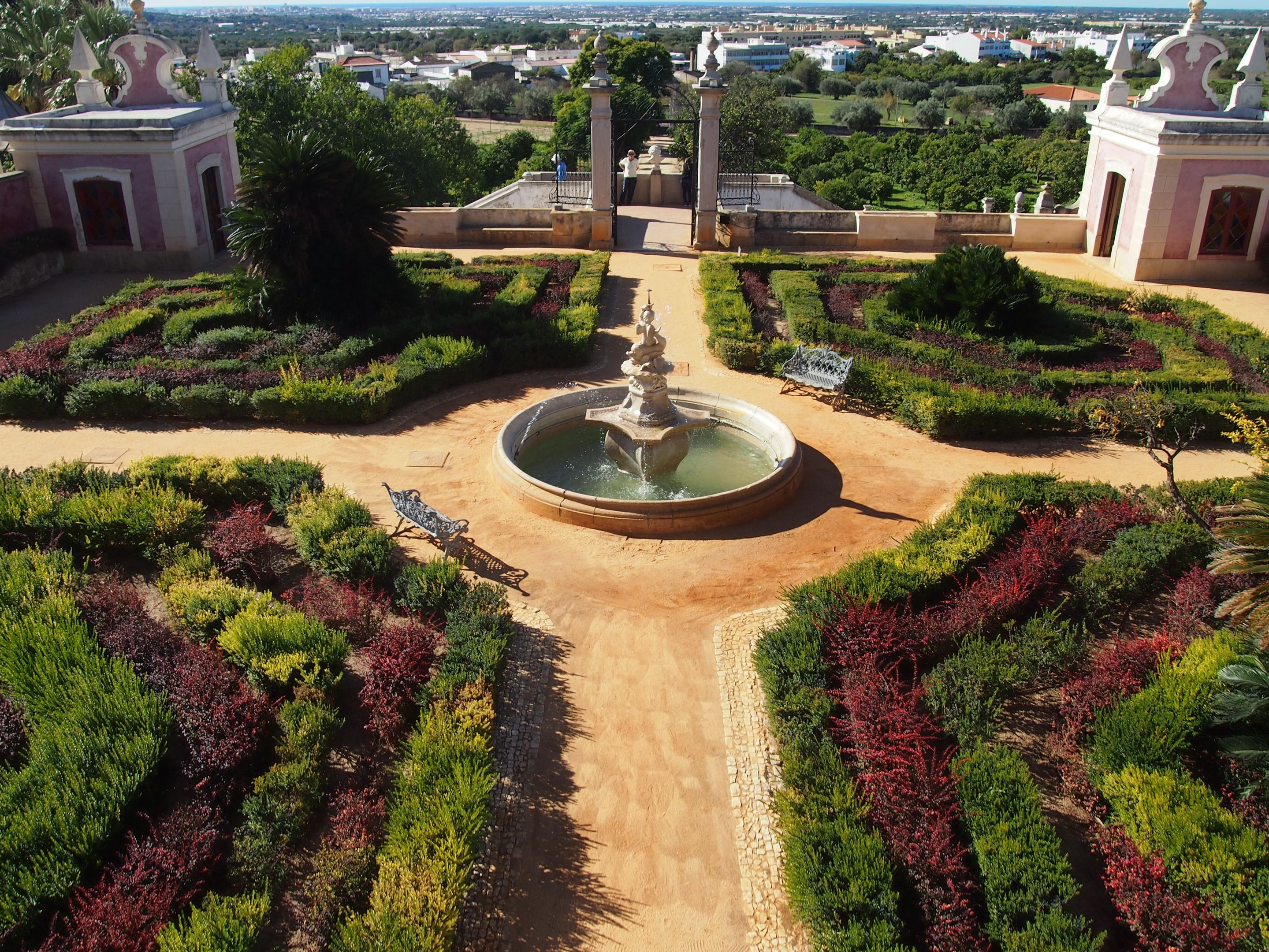 The gardens of Estoi Palace, Algarve, with views down to the ocean.