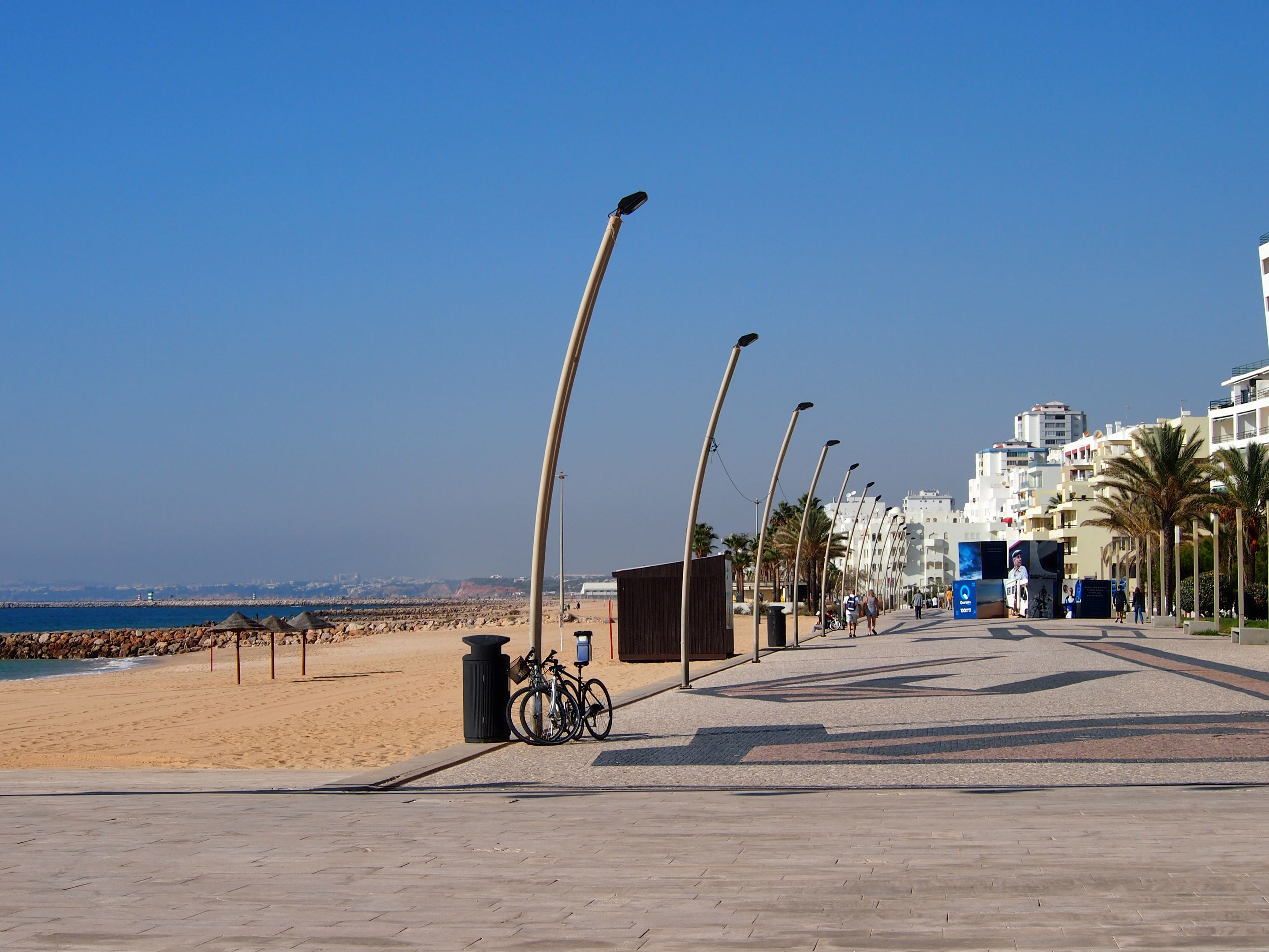 Praia de Quarteira, looking west. At the end of the promenade which runs the entire length of Quarteira.
