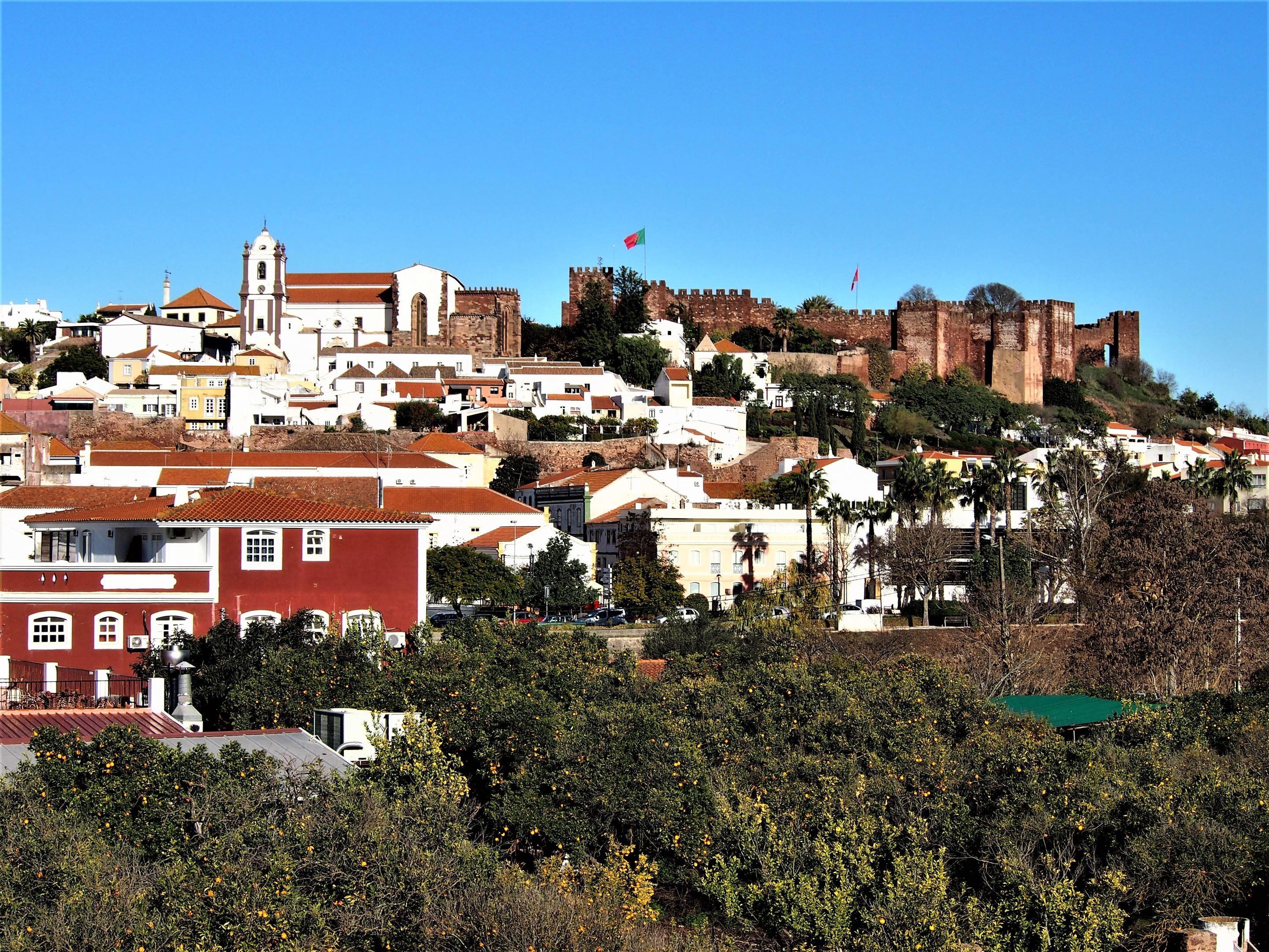 View up the hill towards Silves Castle on the right and Silves Cathedral on the left