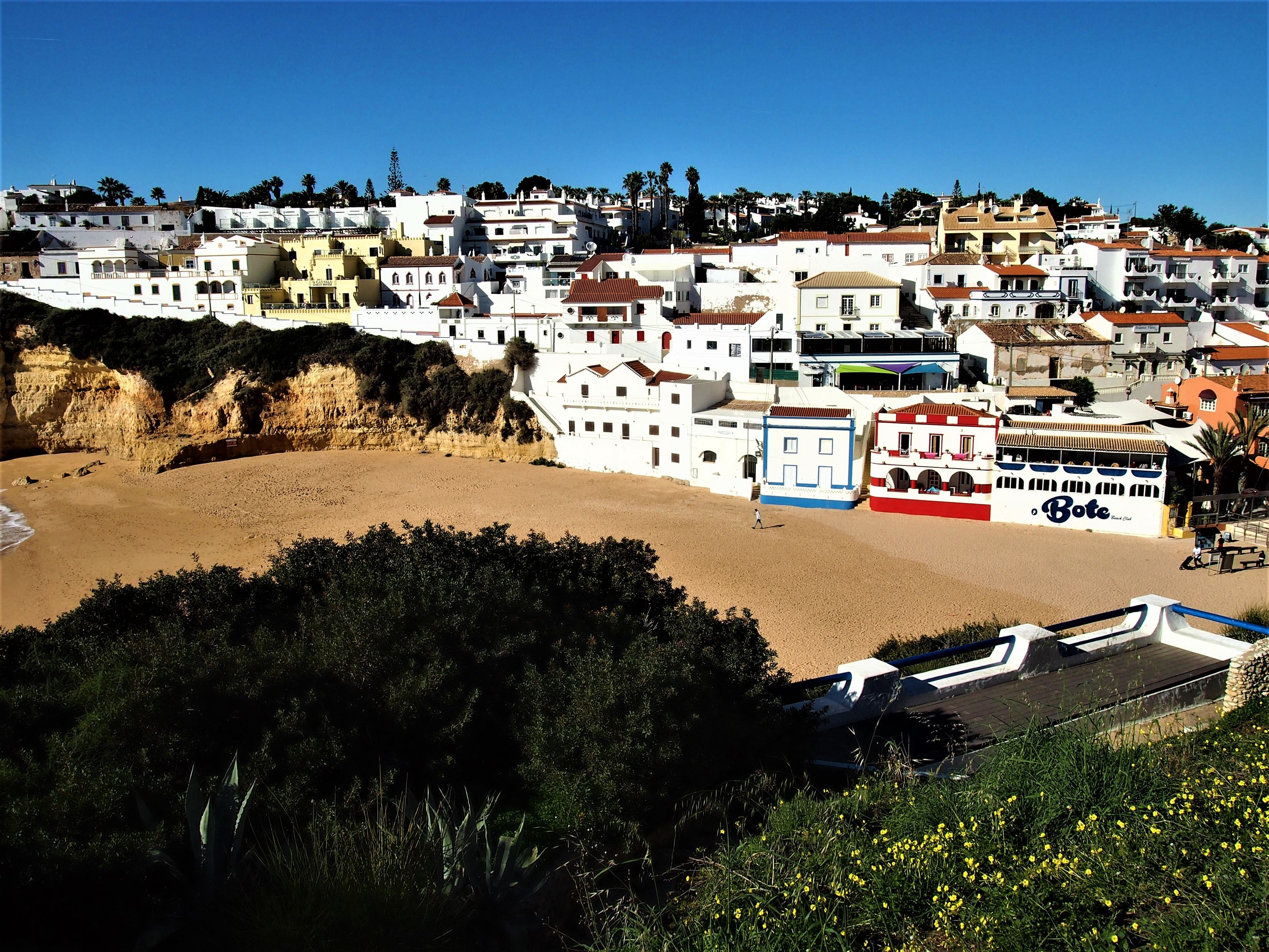 Praia do Carvoeiro with the town of Carvoeiro in the background