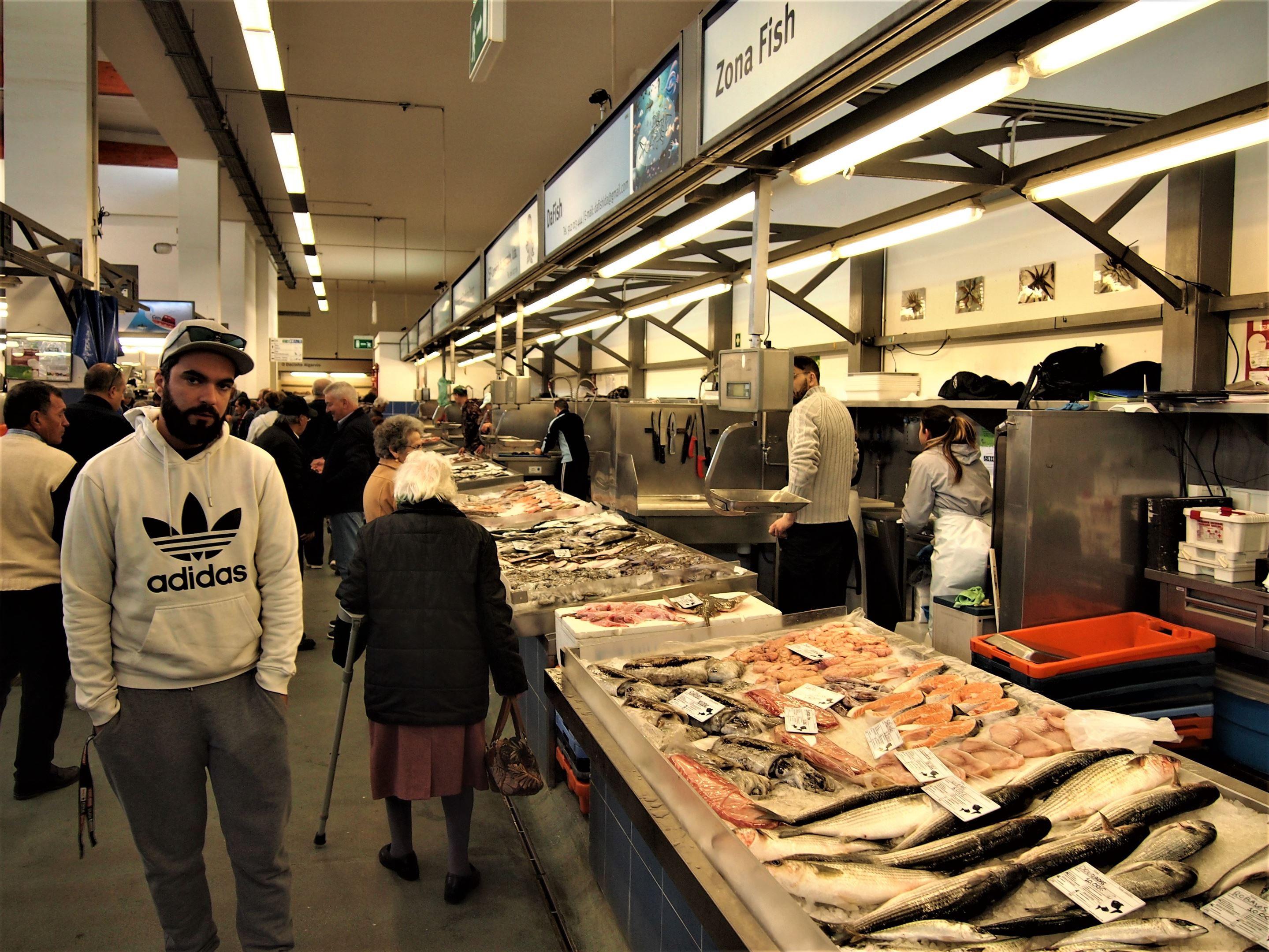 Inside the busy fish section at the Municipal Market, Portimão