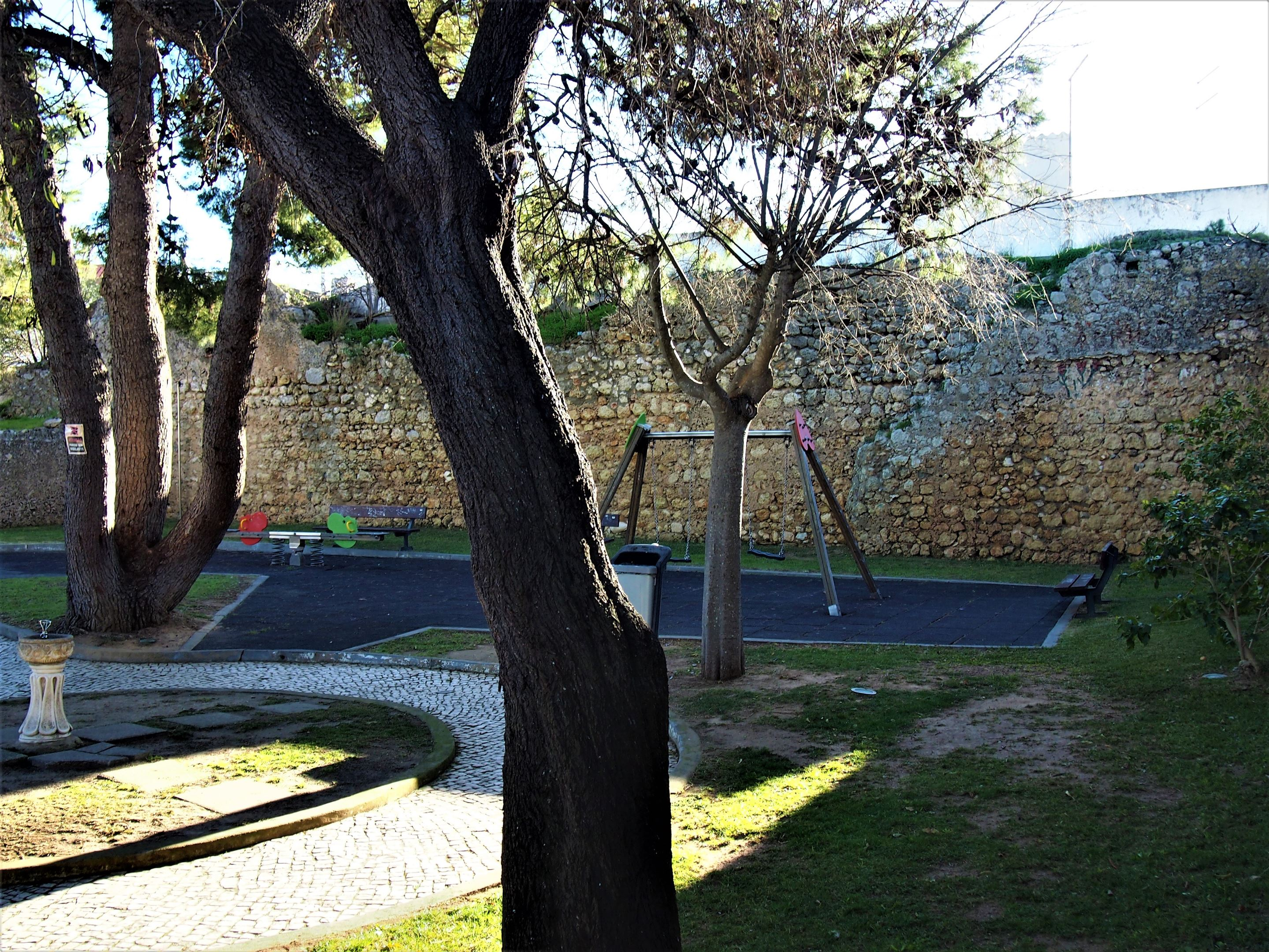 Four walls surrounding a children's playground is almost all that remains of Alvor Castle