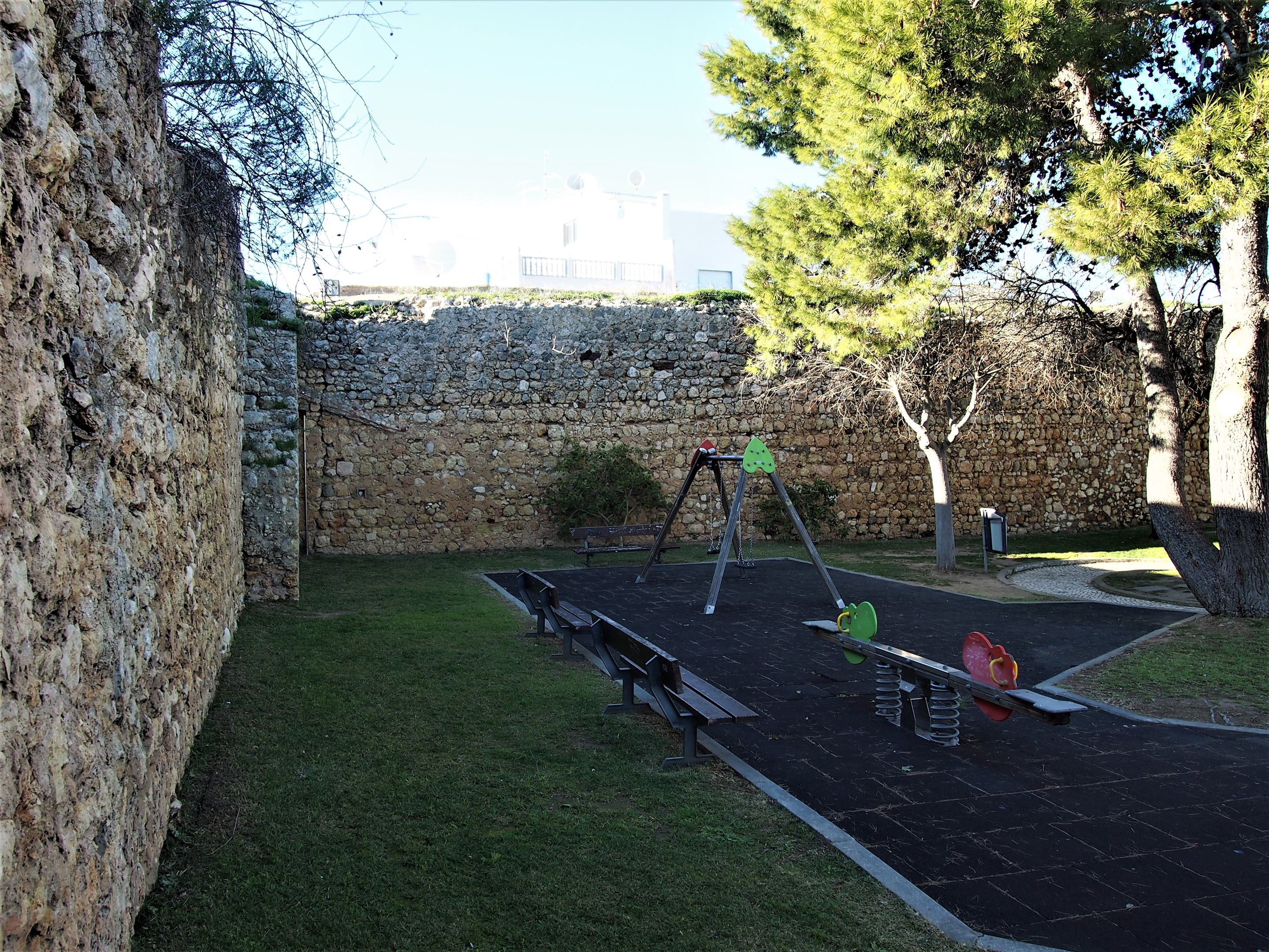 The remains of Alvor Castle - with a children's playground inside the walls