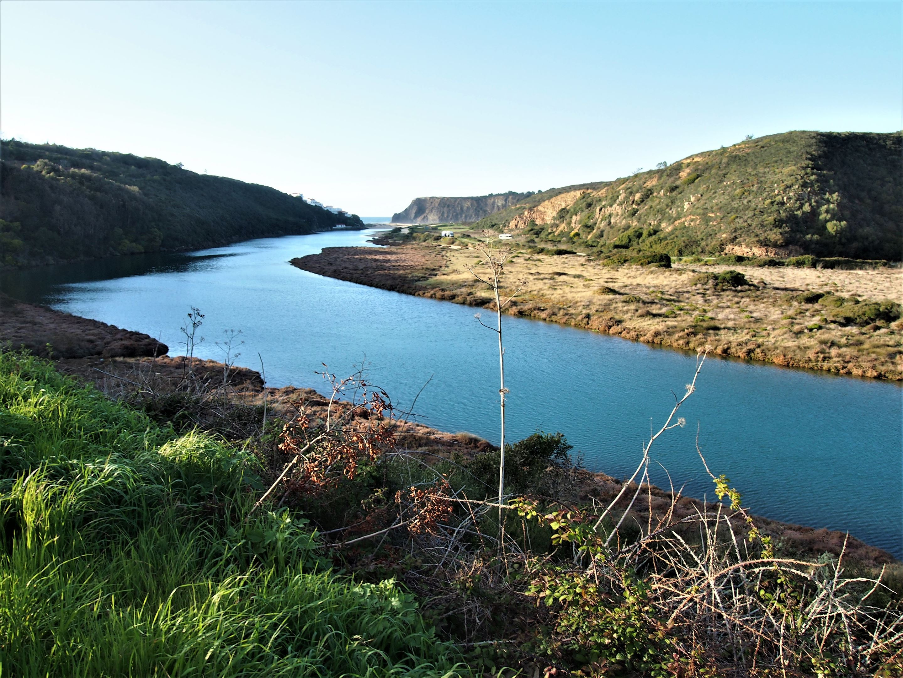 The Ribeira de Seixe (river) as it flows to the Atlantic Ocean with Praia de Odeceixe in the distance. The south side of this river is the Algarve, the north is the Alentejo region.
