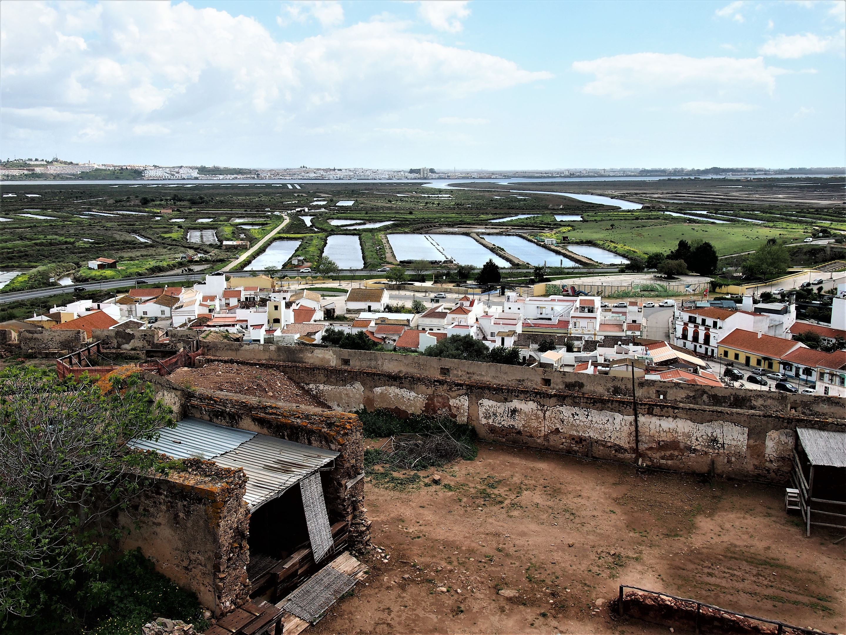 The town of Ayamonte in Spain at the top of the picture, with the Guadiana river just below dividing Spain and Portugal. The salt pans of the Castro Marim with some remains of the castle at the bottom