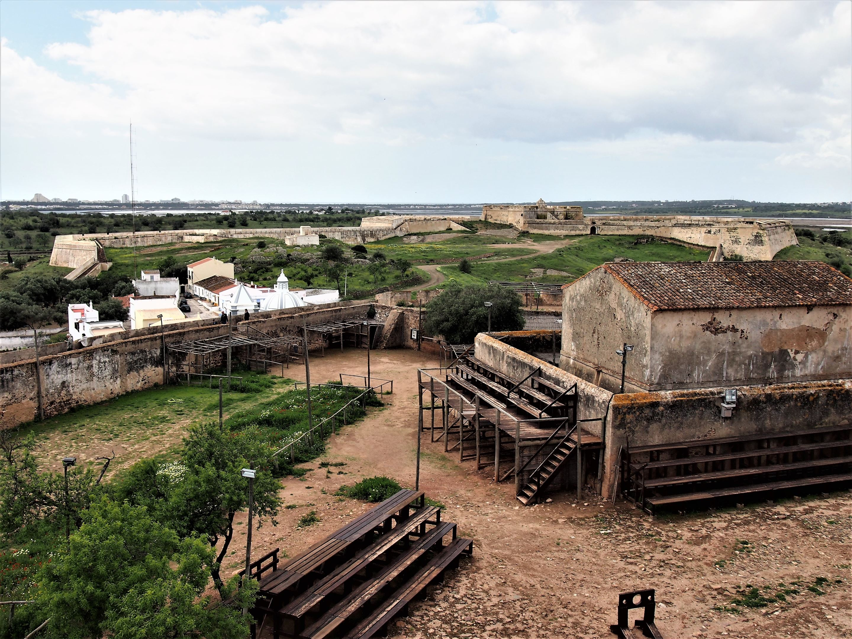 The Fort of São Sebastião in the background, with buildings inside Castro Marim castle below