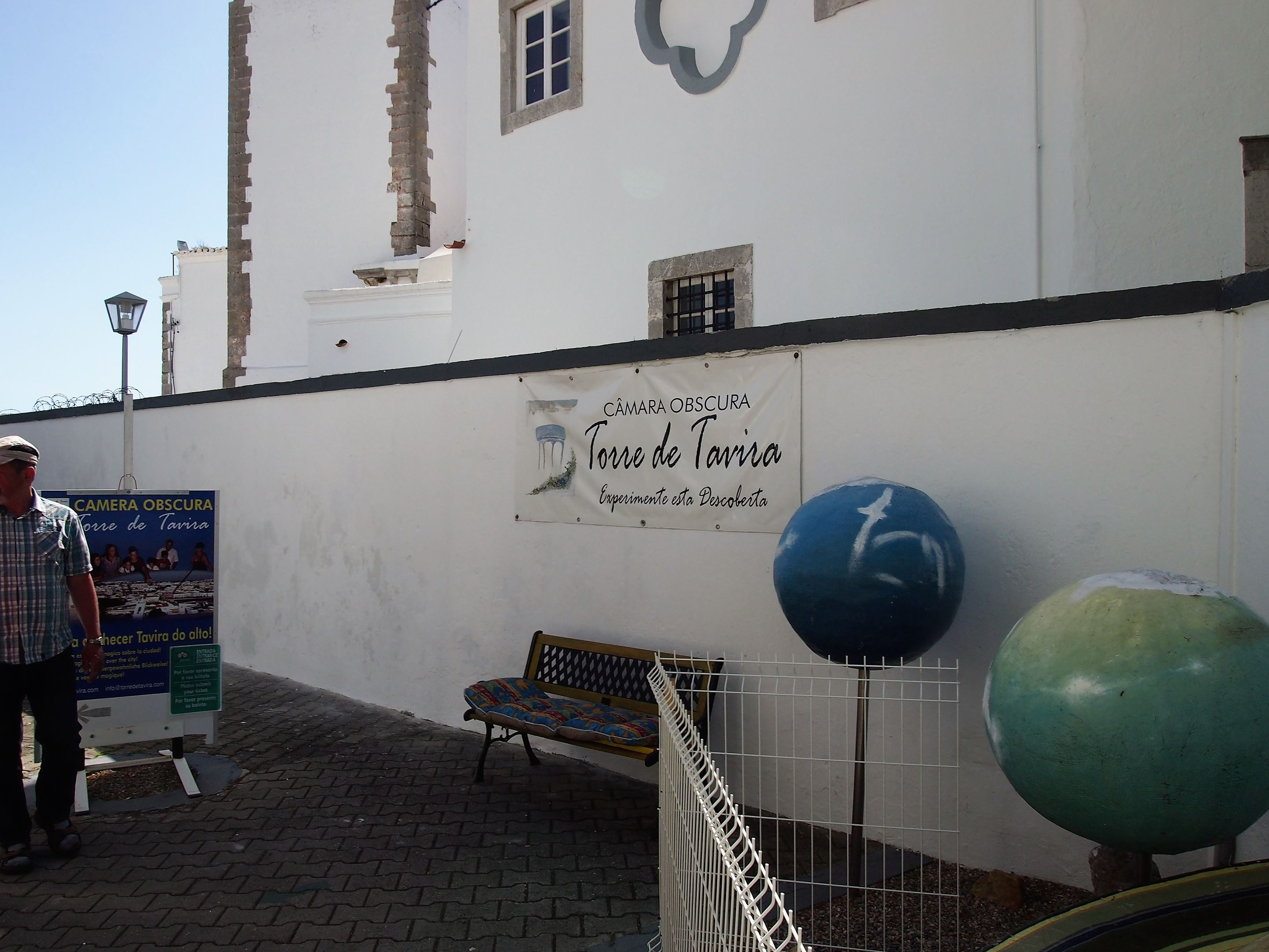 At the entrance to the Torre de Tavira (Tavira Tower) which house the camera obscura at the top.