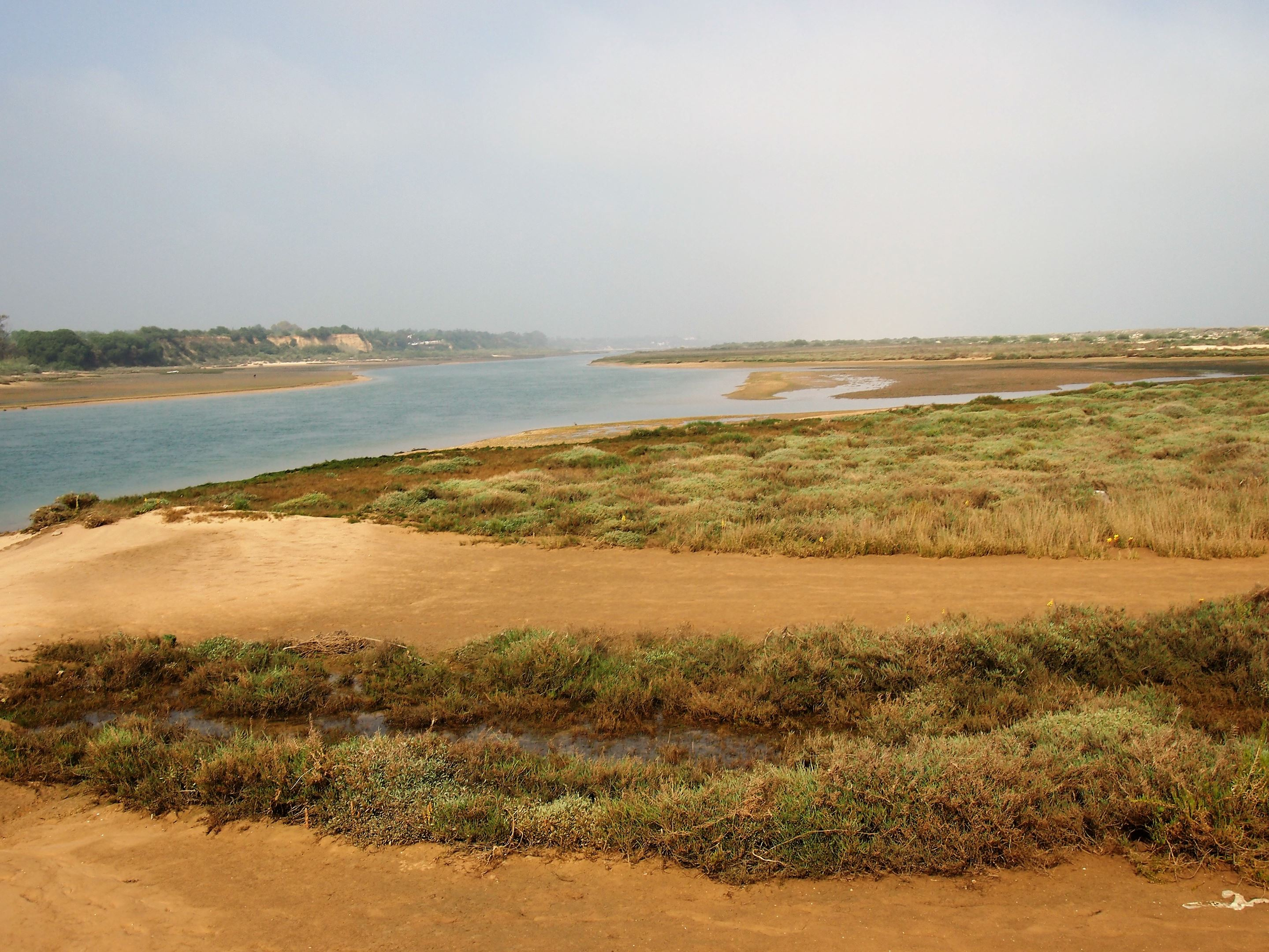 Ilha de Cabanas on the right, and the mainland on the left, separated by a small channel of water near Tavira