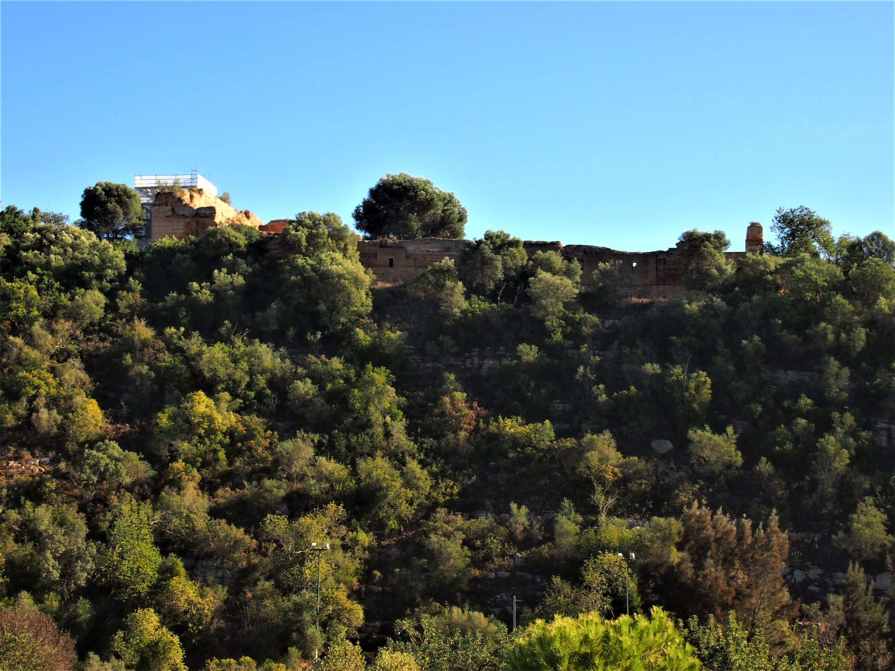 The remains of the Castle of Paderne at the top of the hill.