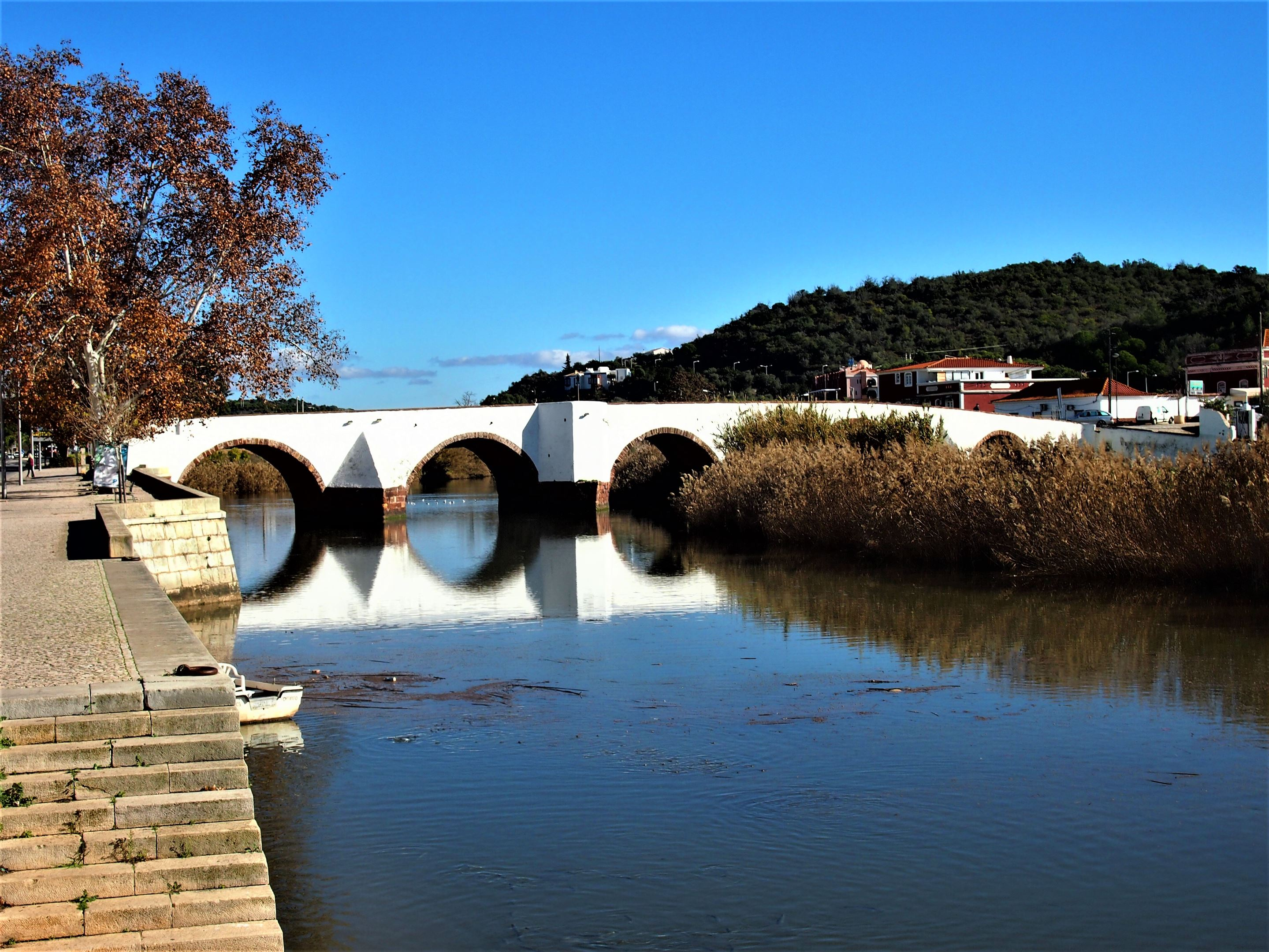 The Arade River in Silves flowing under the Roman Bridge.