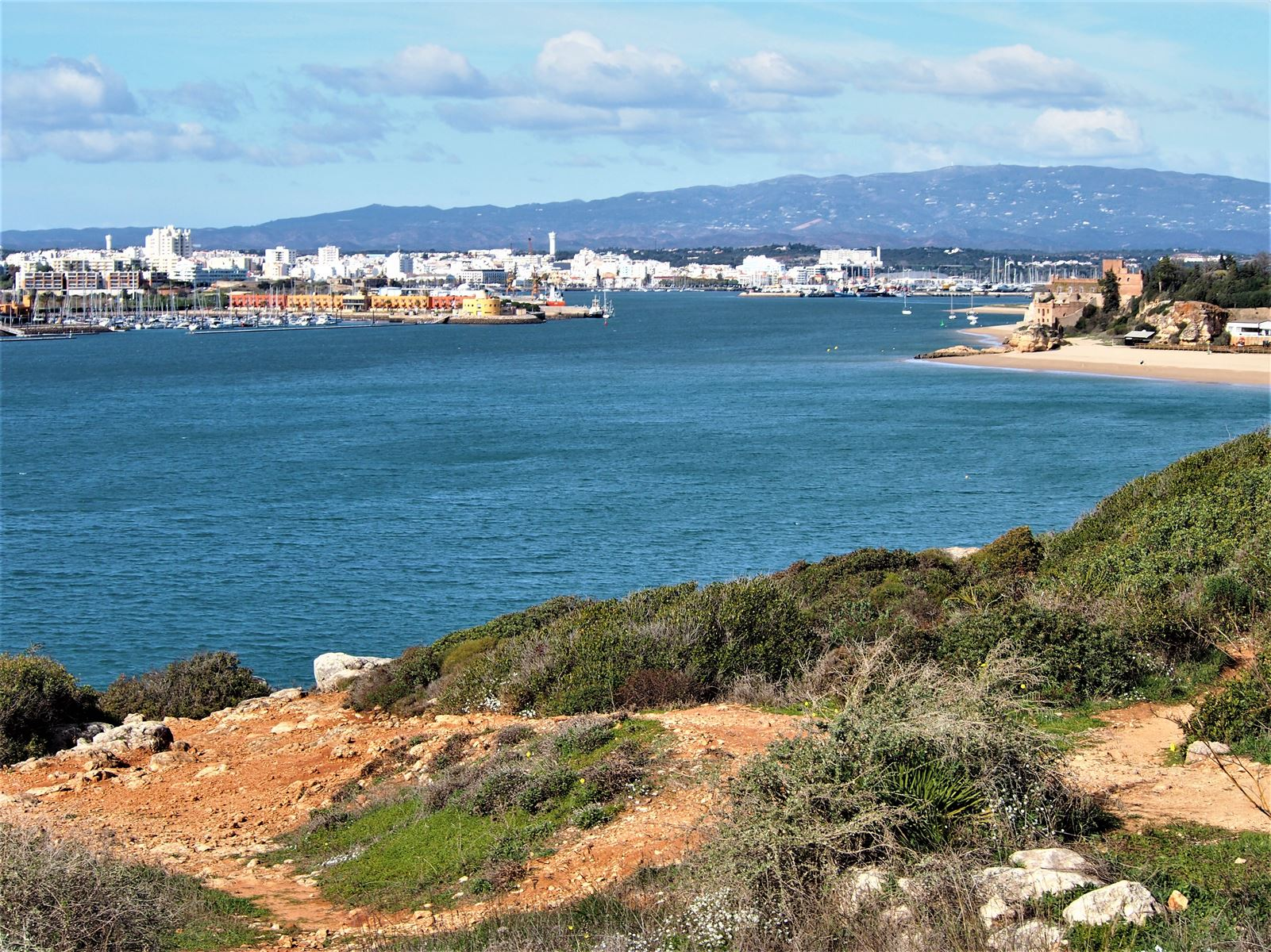 The mouth of the Arade River, with Portimao and its marina on the left, and Ferragudo on the right.