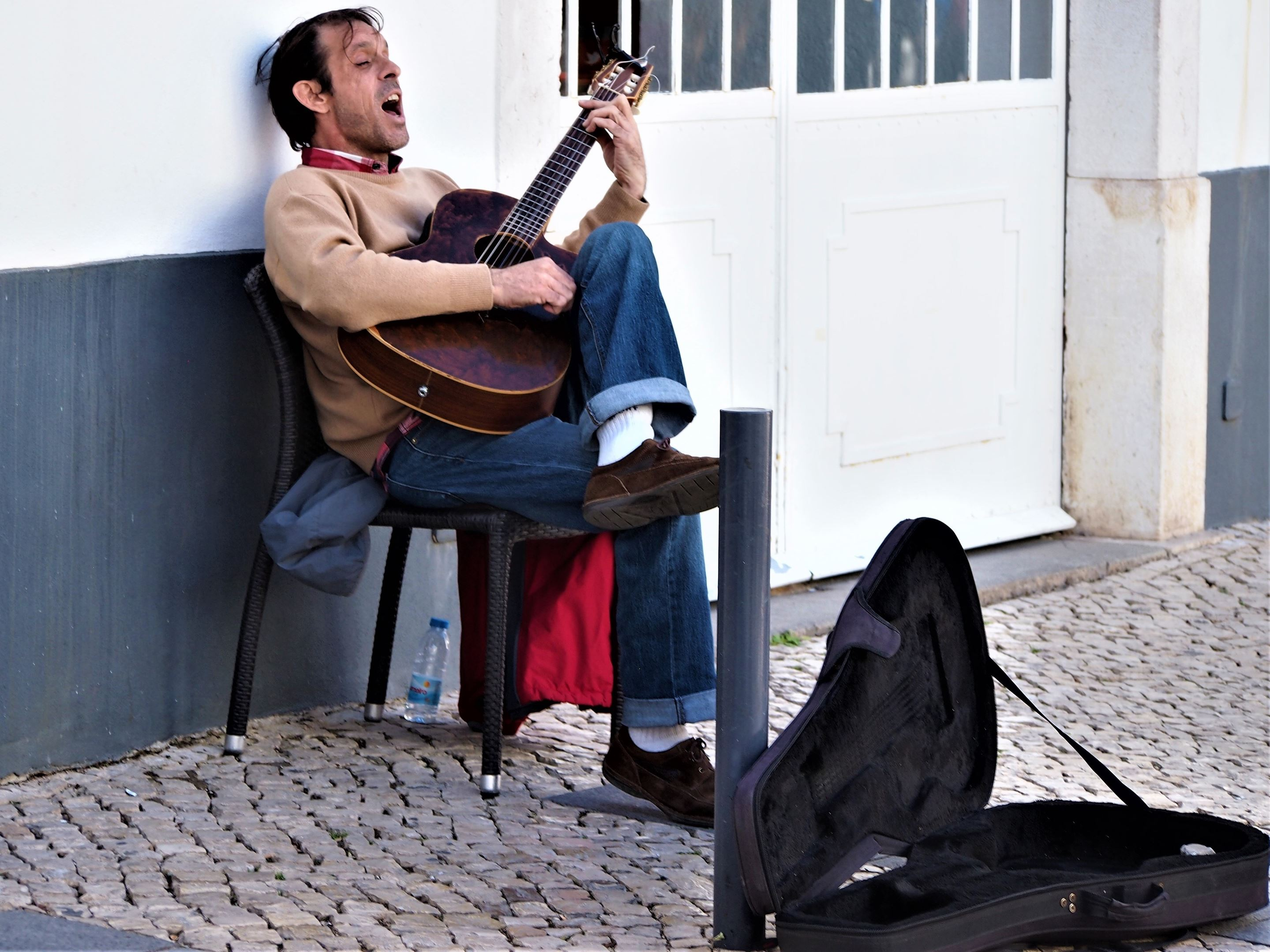 This guy was giving an incredible free concert to a small number of people opposite in a restaurant, fantastic singer - Lagos
