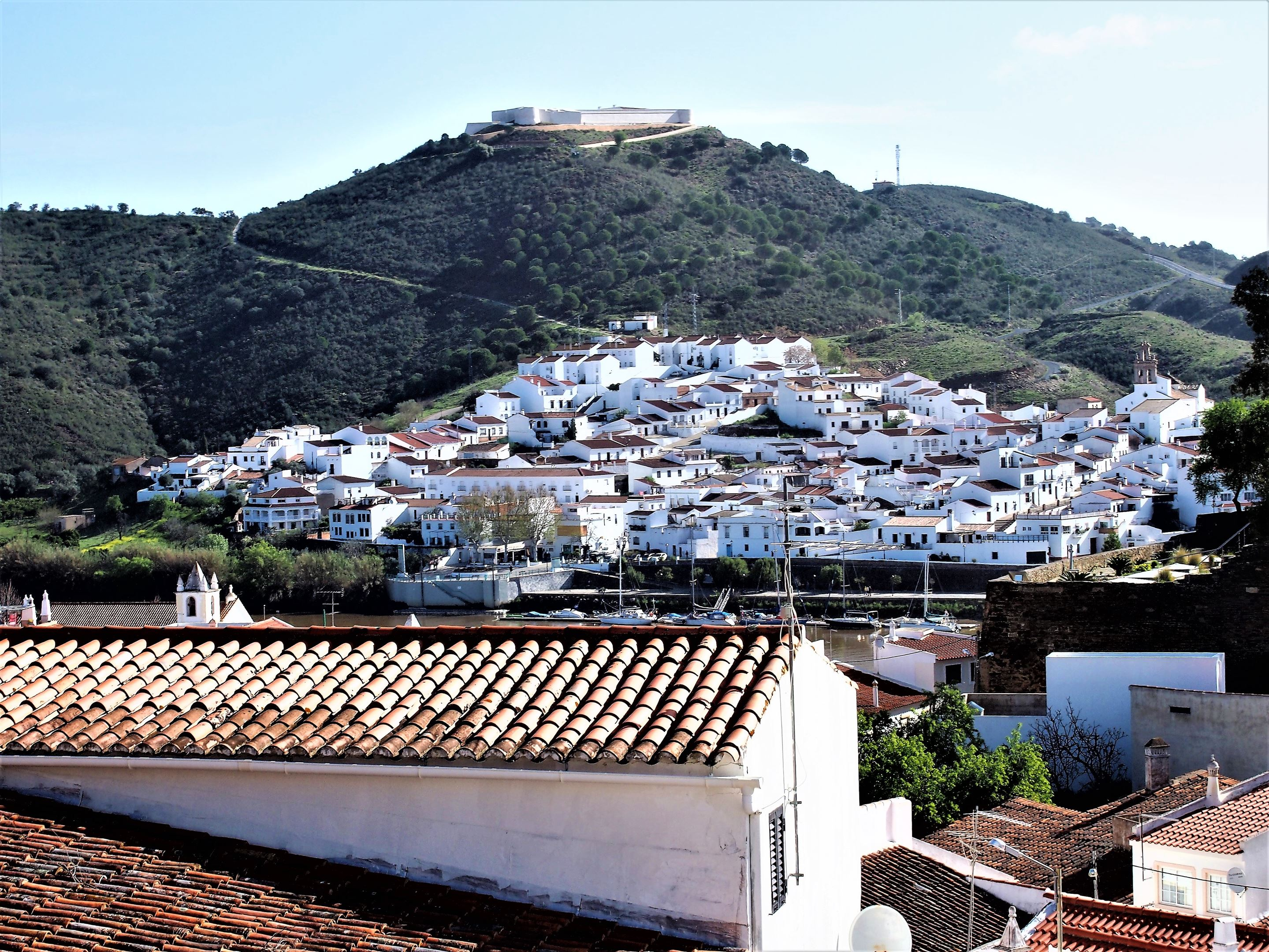 Across the Guadiana River, Sanlúcar de Guadiana, Spain with the castle at the top of the hill