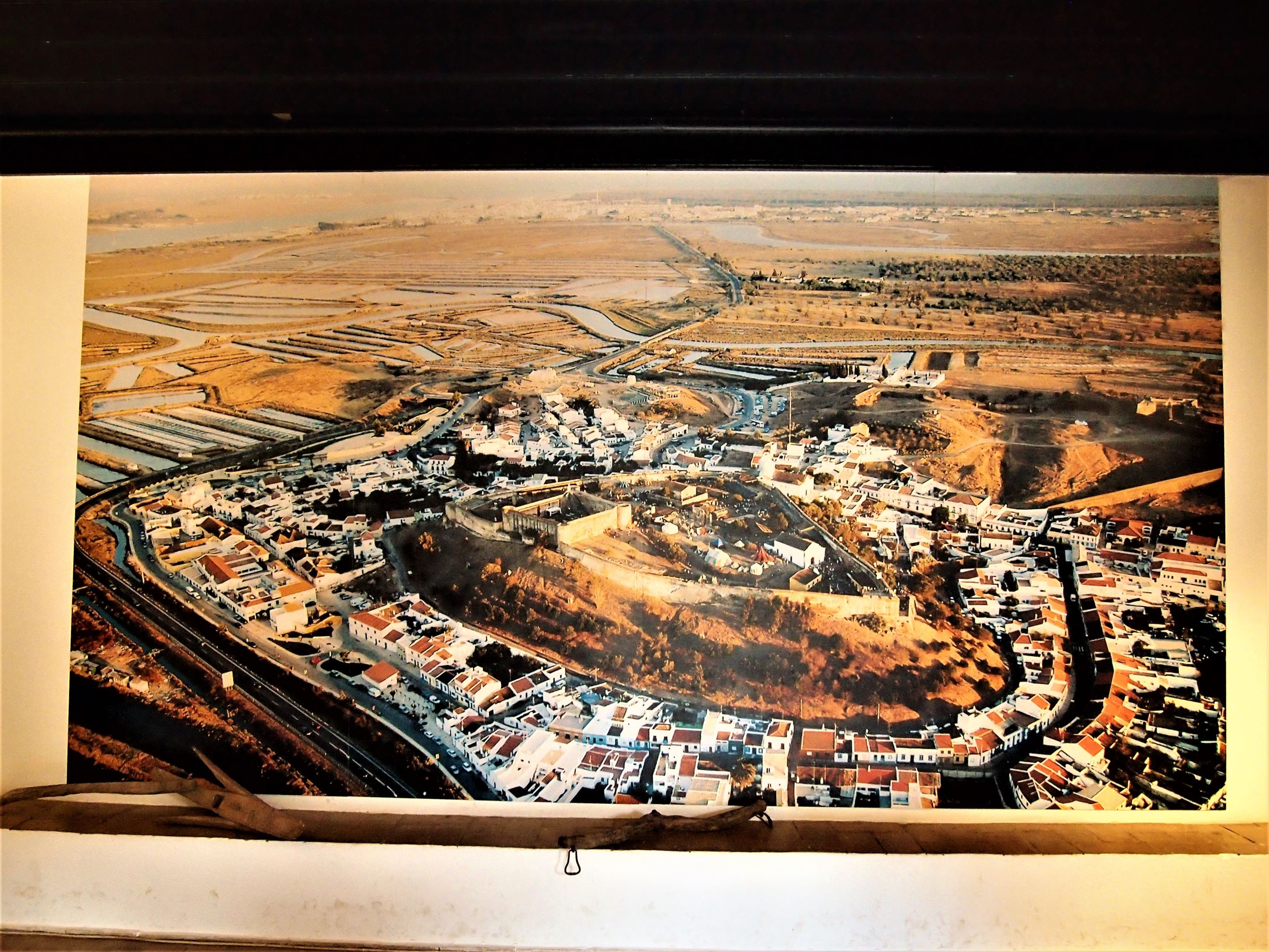 A picture at the entrance to the archaeological museum in Castro Marim, showing the town and the castle sitting strategically at the top of the hill.