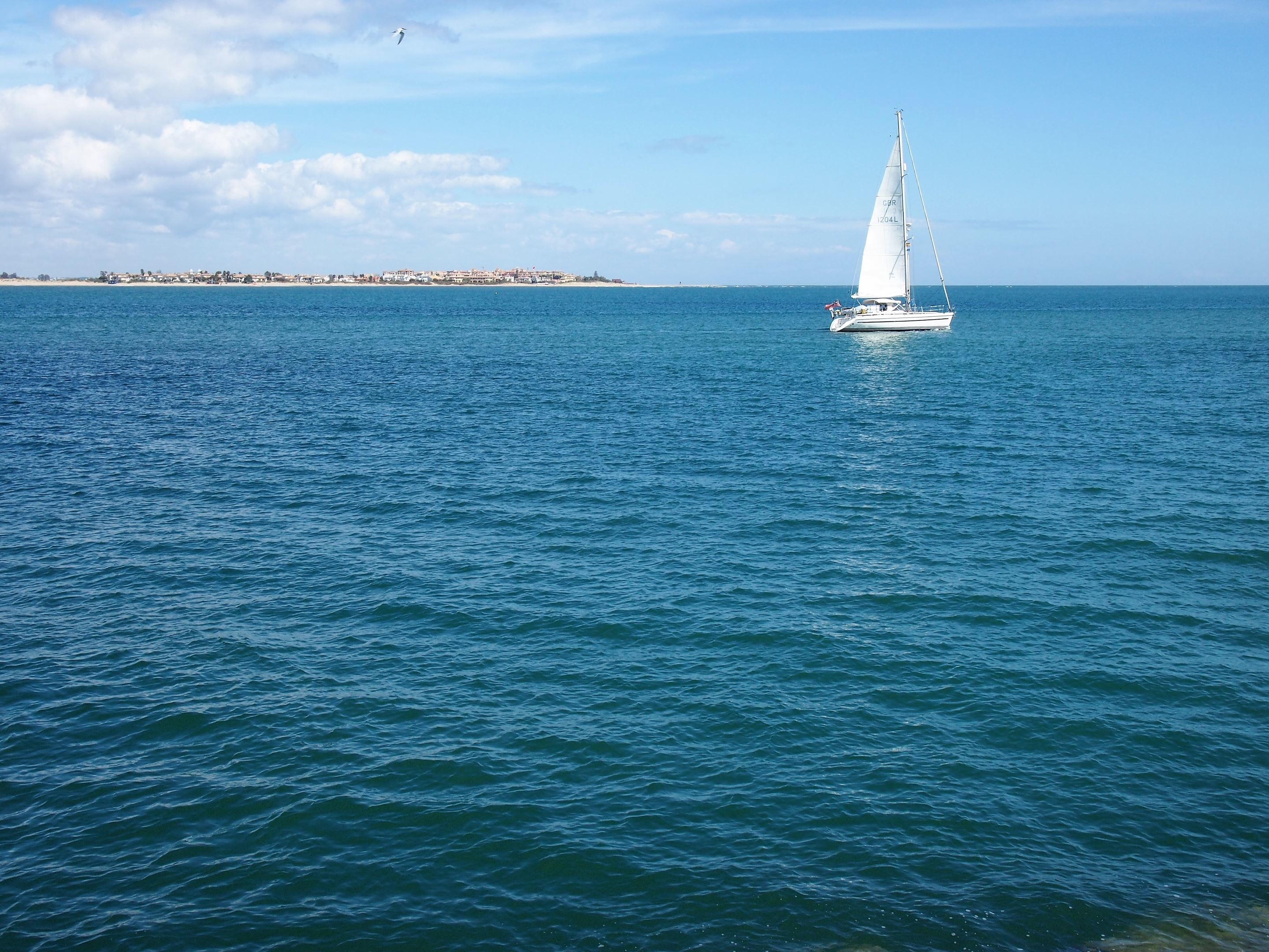 Sailing into the Atlantic Ocean. At the mouth of the Guadiana River, walking to Praia de Santo António.