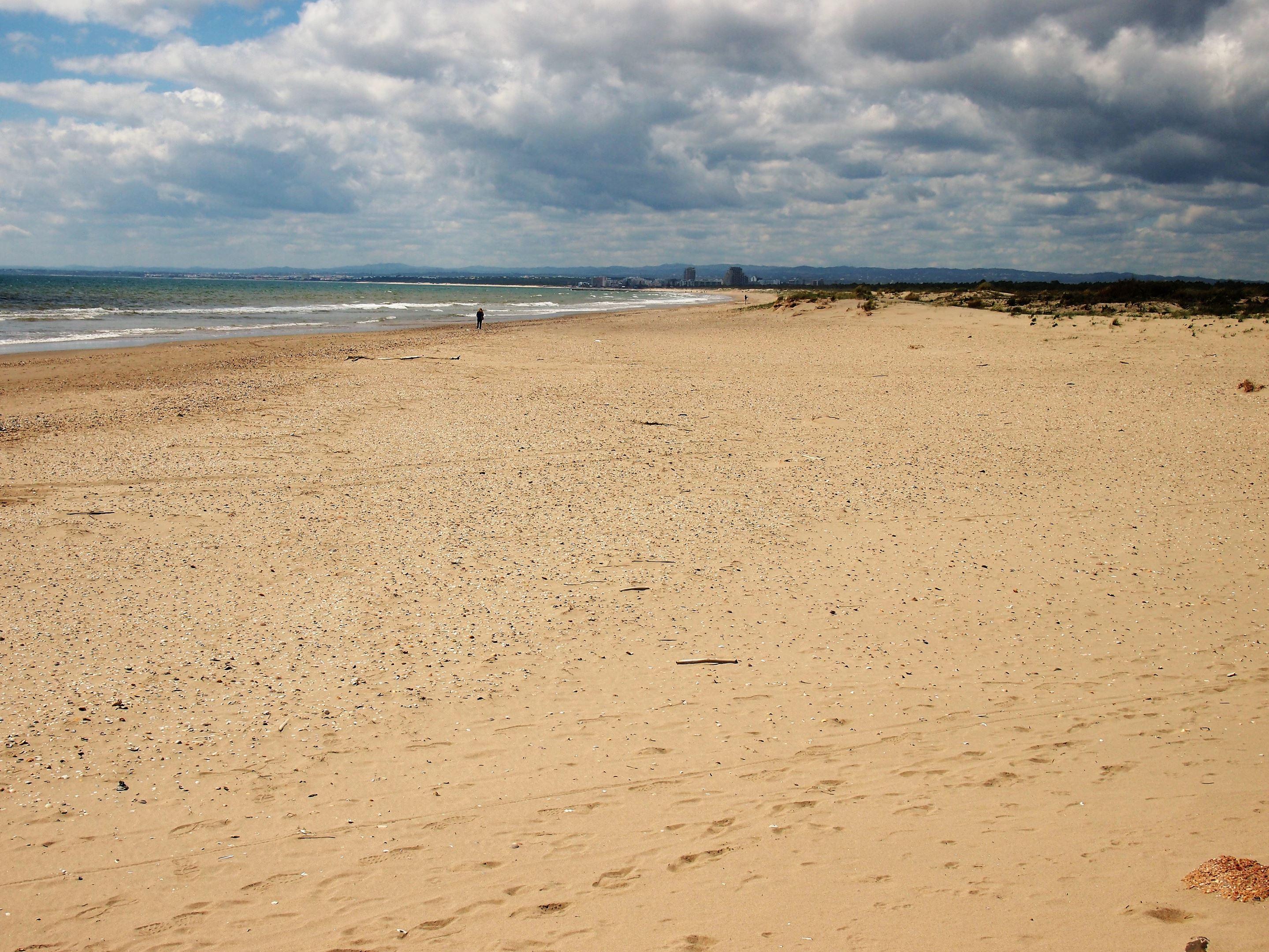 Praia de Santo António. It's a pleasant walk to reach this beach but a long walk. The tourist train is a good option.